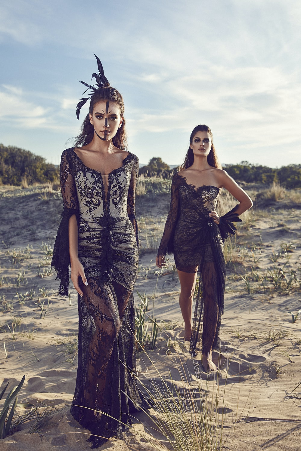 women wearing black lace dresses in dessert