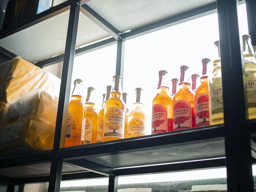 assorted-labeled bottle lot on rack