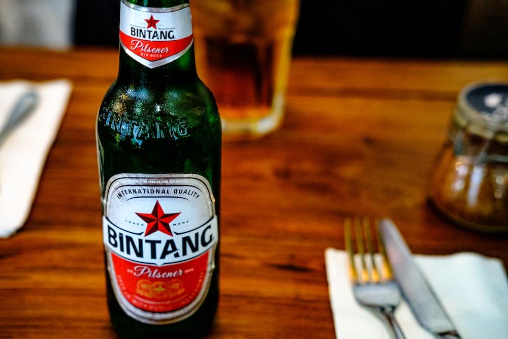 selective focus photography of Bintang bottle