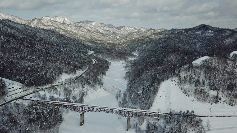 aerial photography on bridge surround by mountains