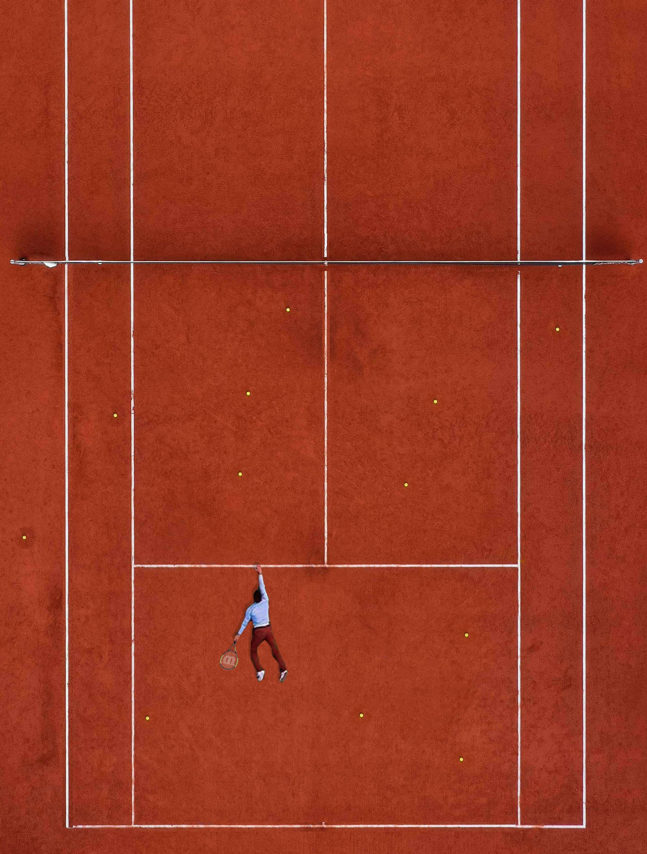 man lying on tennis field