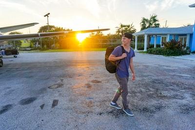 smiling man walking while looking