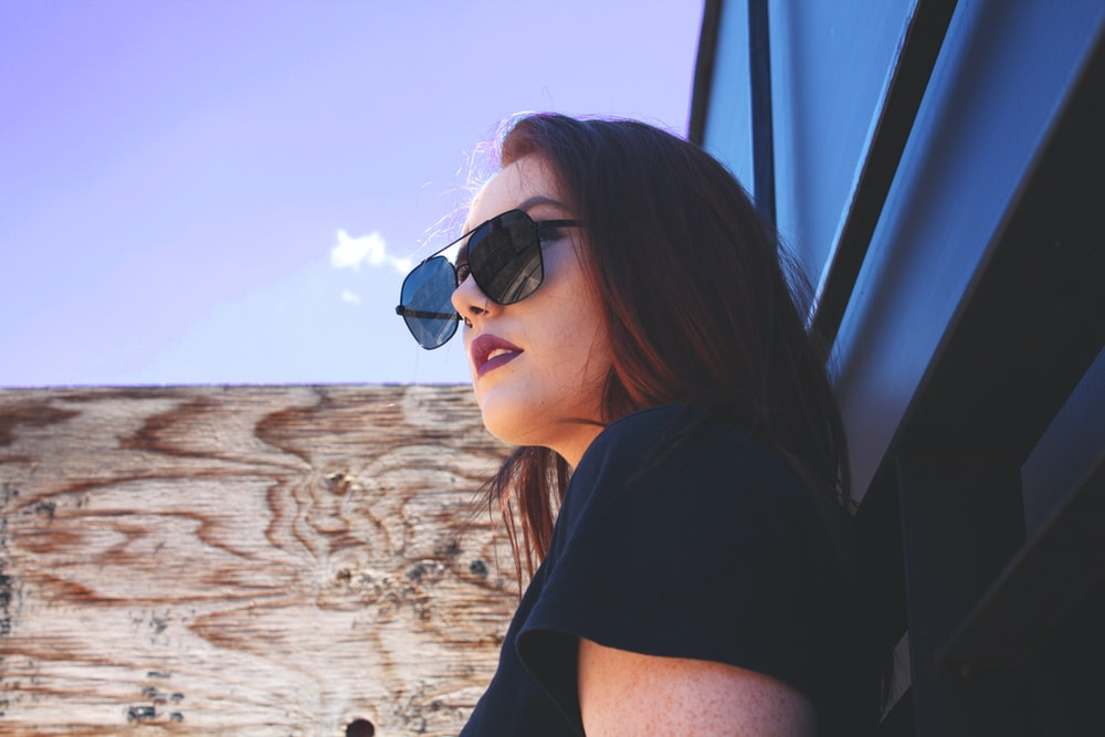 woman in black shirt wearing sunglasses