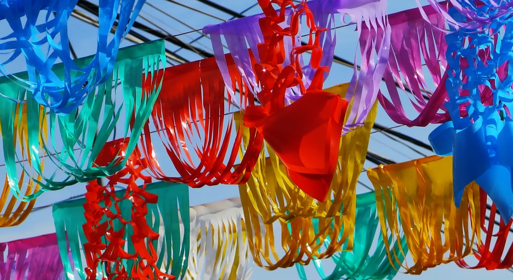 assorted-color hanging decors under blue sky