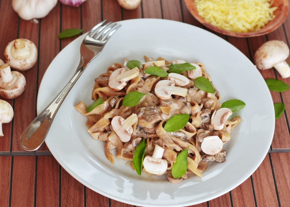pasta with mushroom with leaves on plate