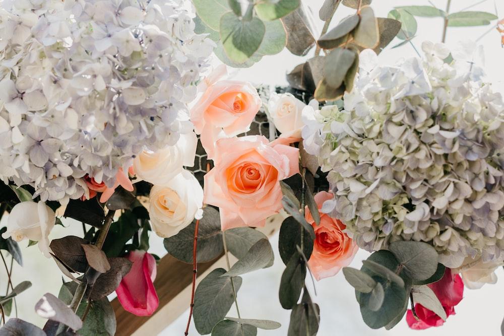 orange, white, and red roses flower arrangement