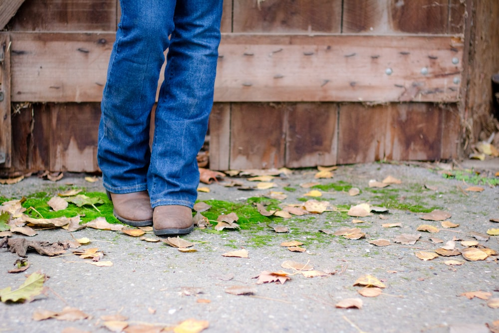 person wearing brown leather boots