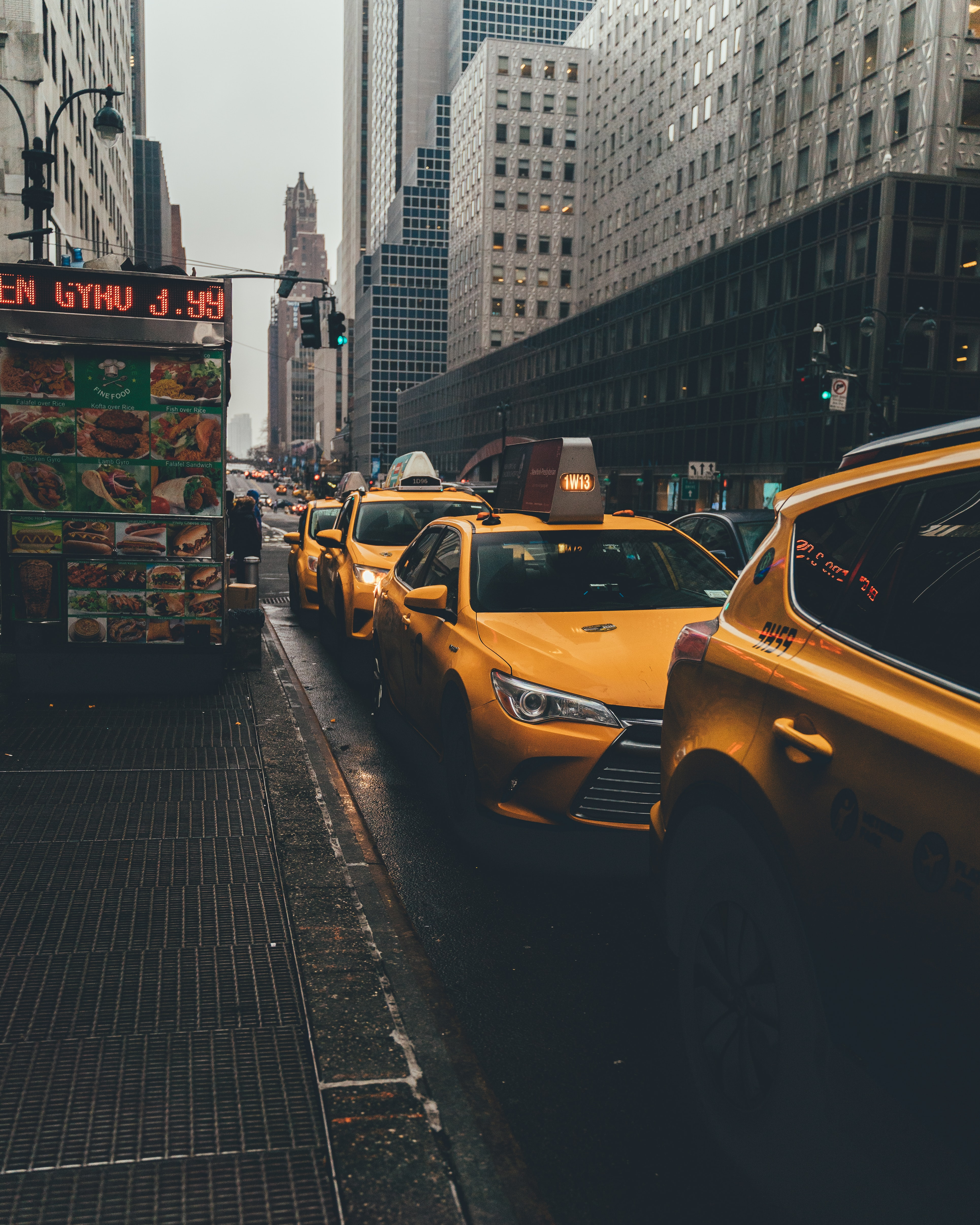 taxis on road during daytime