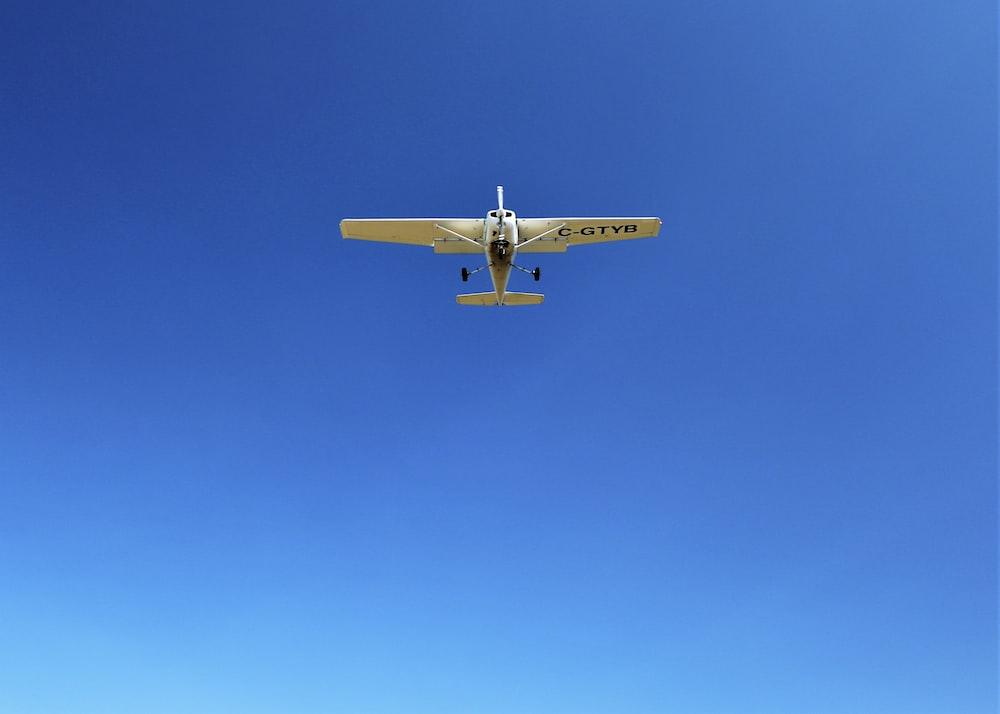 white monoplane on flight