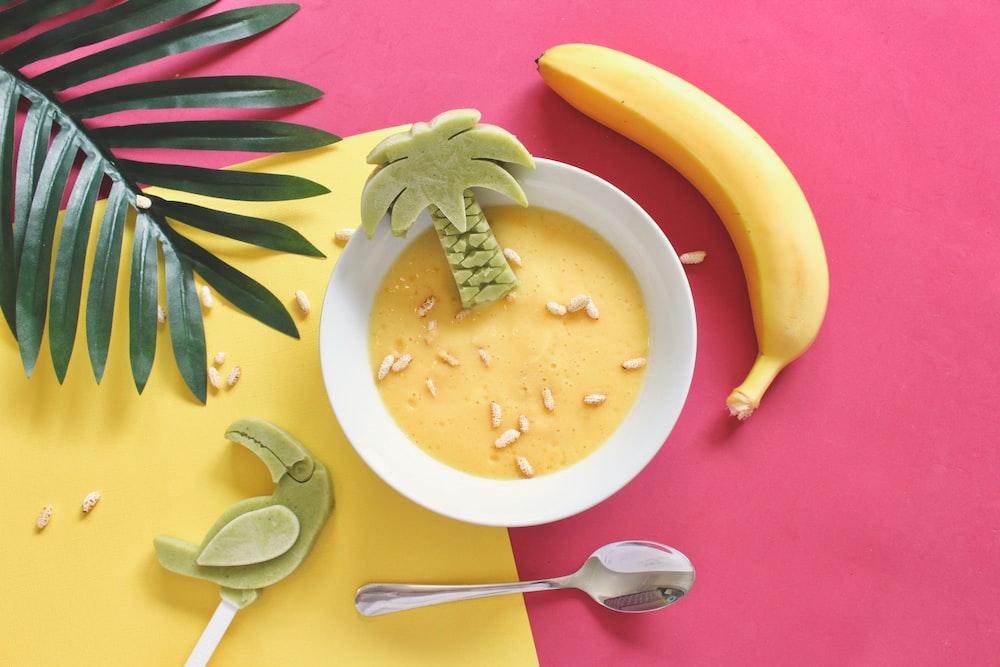 oatmeal on white bowl beside yellow banana