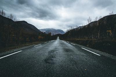 empty road during daytime asphalt teams background