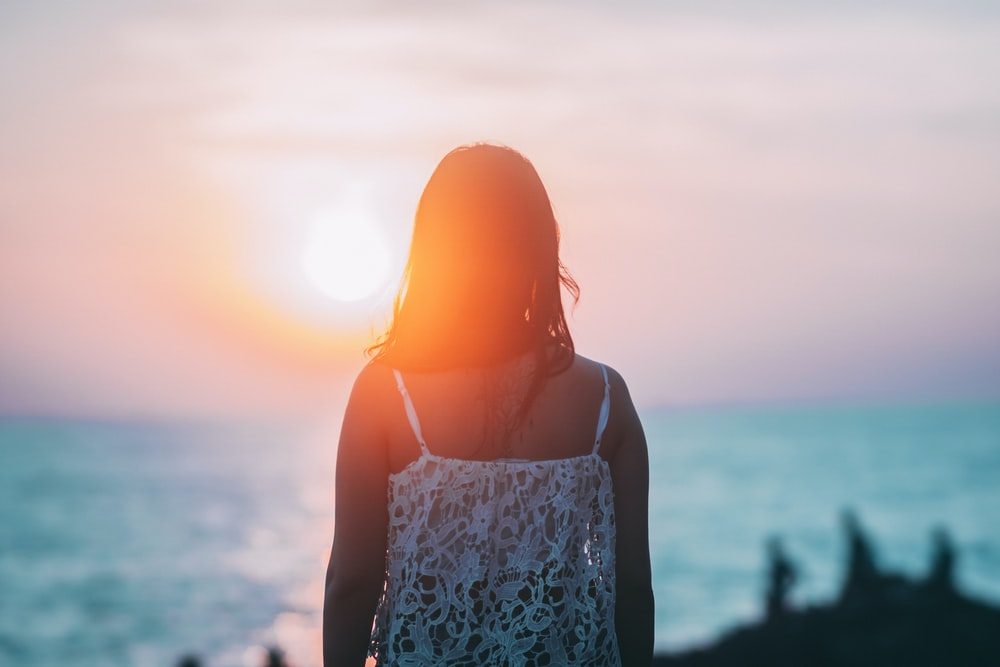 woman overlooking shore