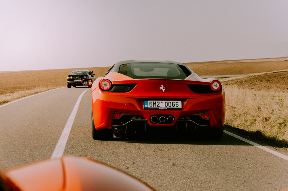 red Ferrari coupe on road