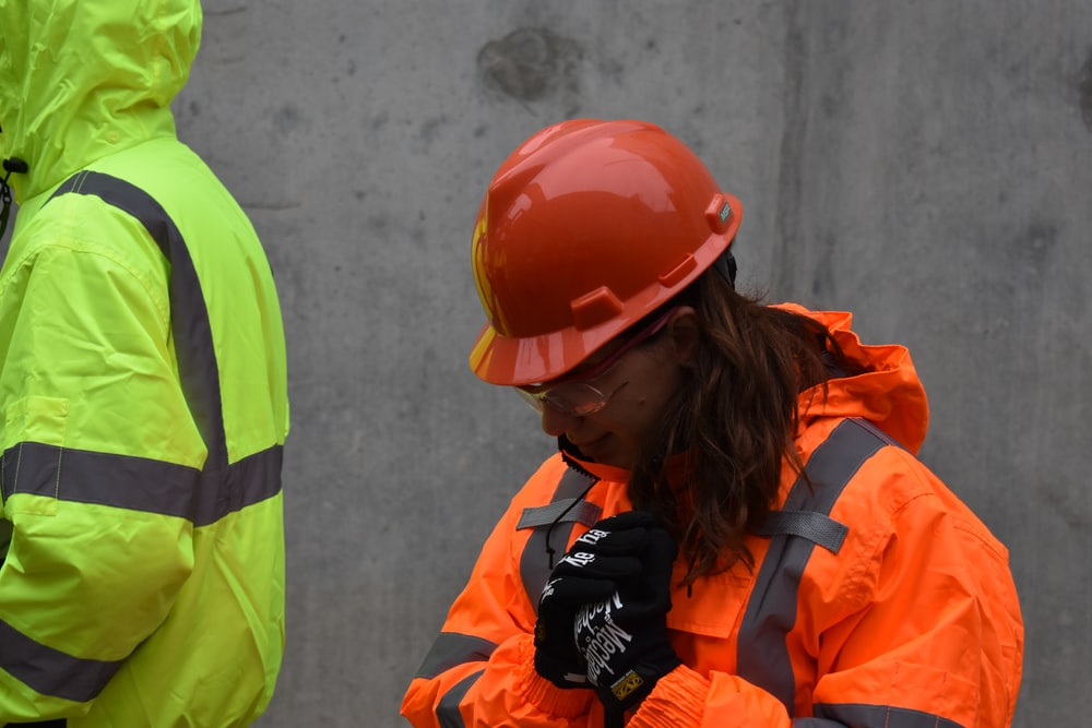 woman wearing red hard hat