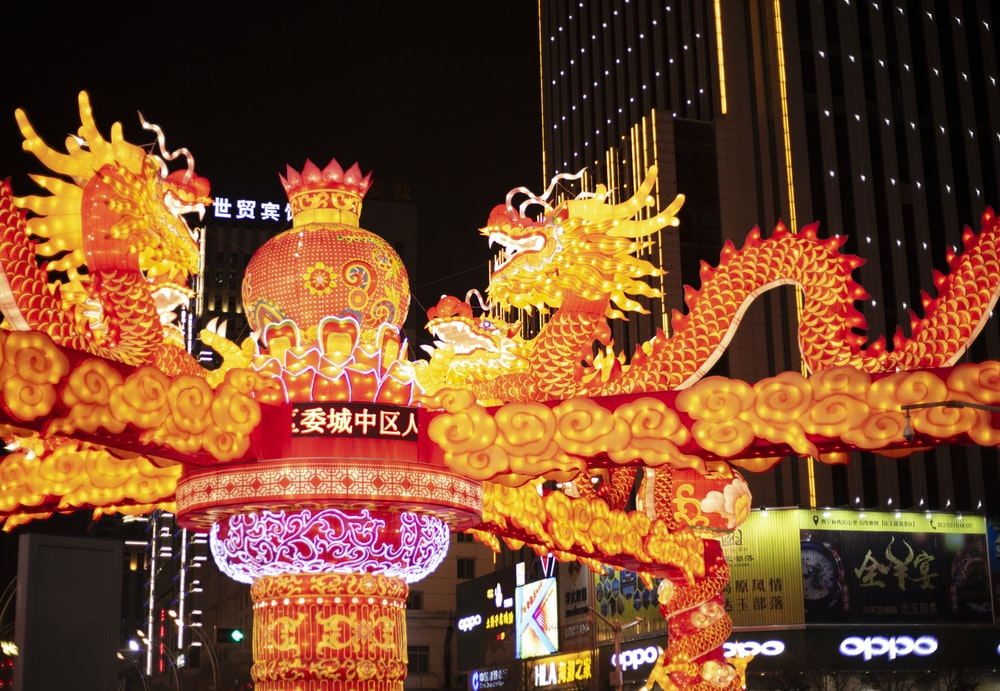 lighted dragon decors near building at nighttime