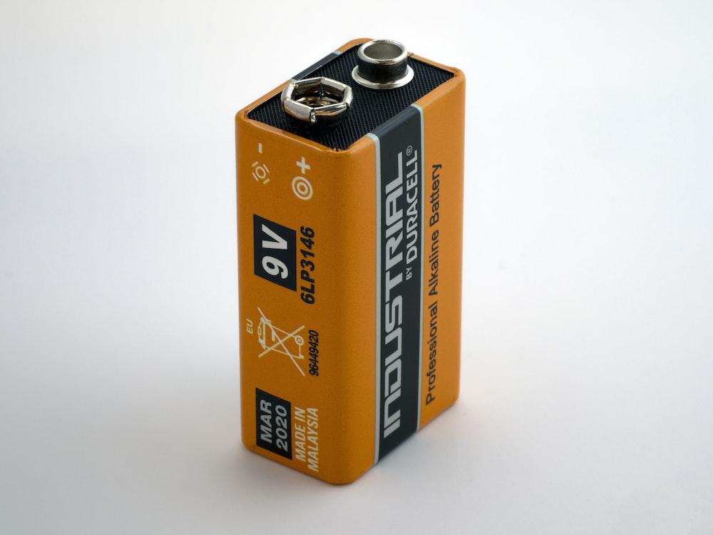 orange 9V Duracell battery