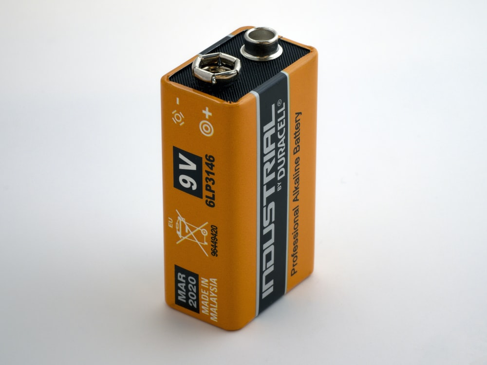 orange 9V Duracell battery