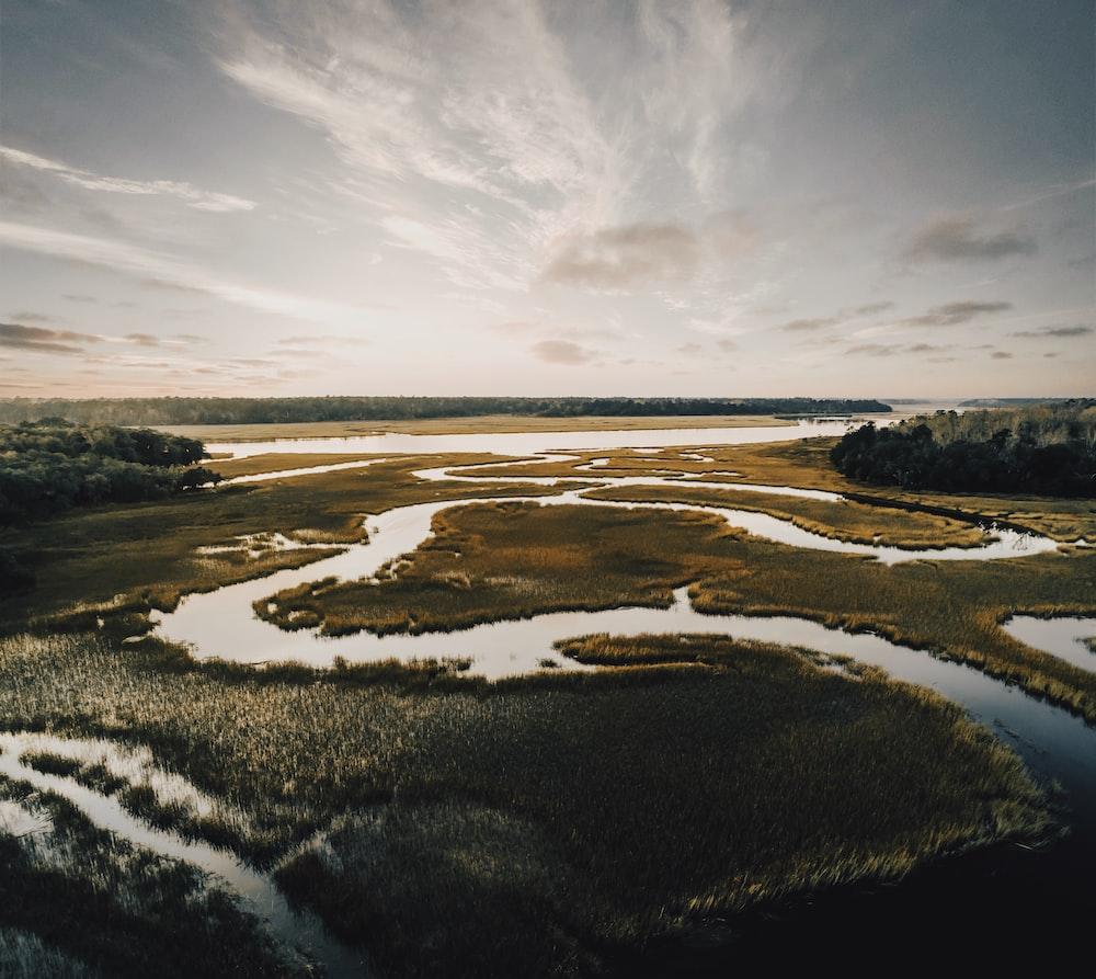 winding river across plains under downcast ssky