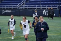 female lacrosse team on field