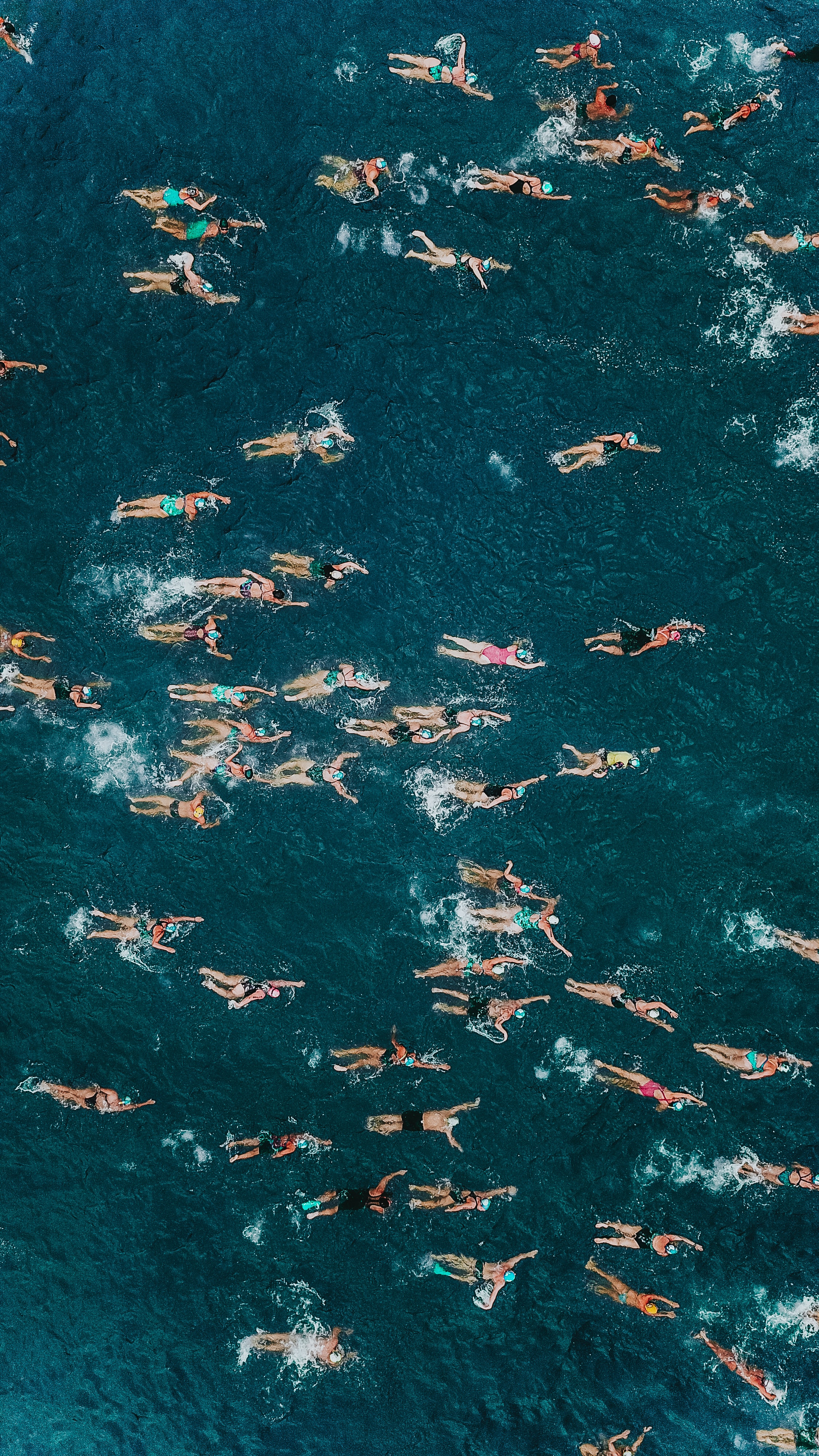 people on body of water in high-angle photography
