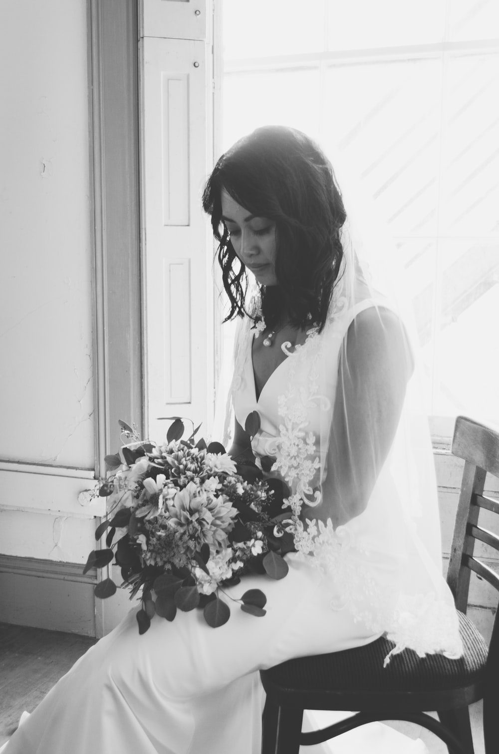 grayscale photography of woman wearing wedding dress