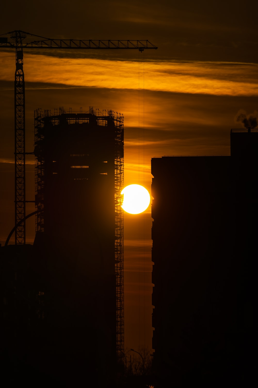 silhouette of crane tower