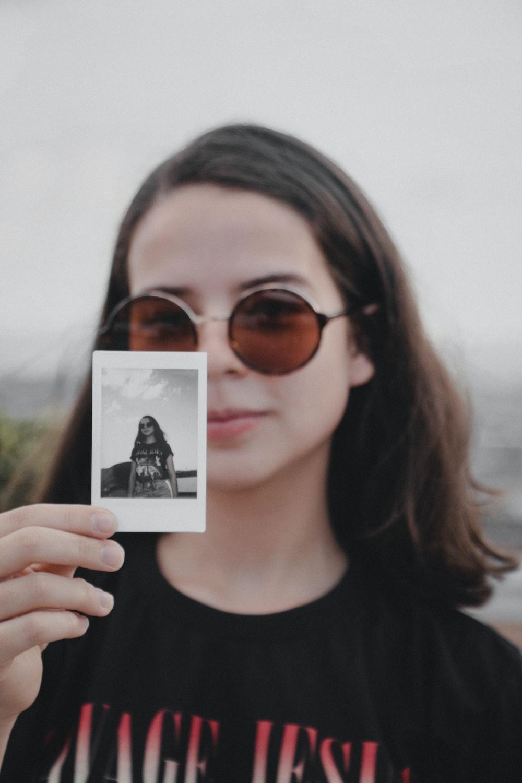 woman holding photo
