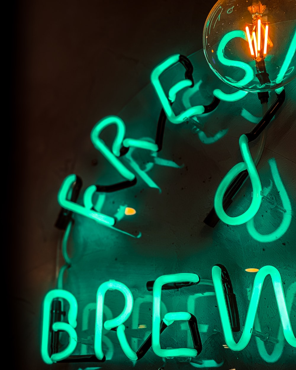 green neon light signage turned-on