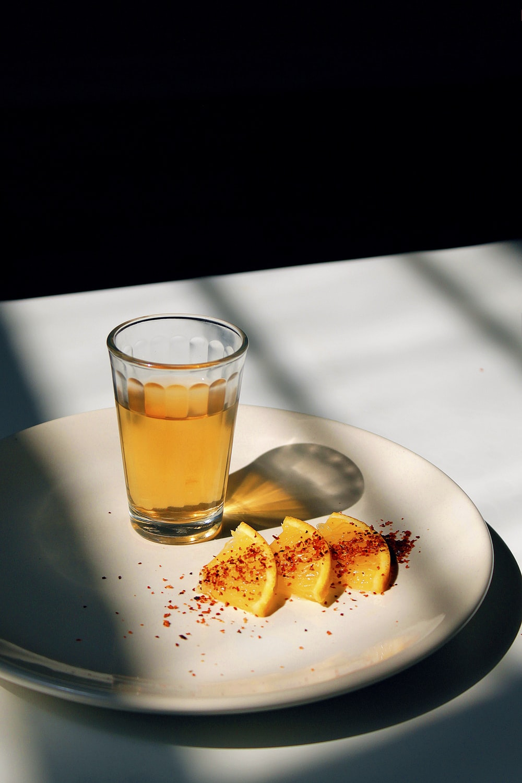 round white ceramic plate with sliced oranges