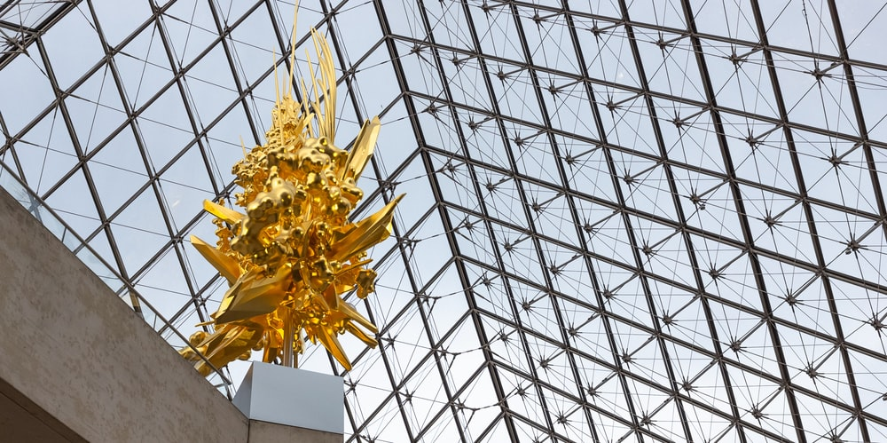 gold-colored statue low-angle photography