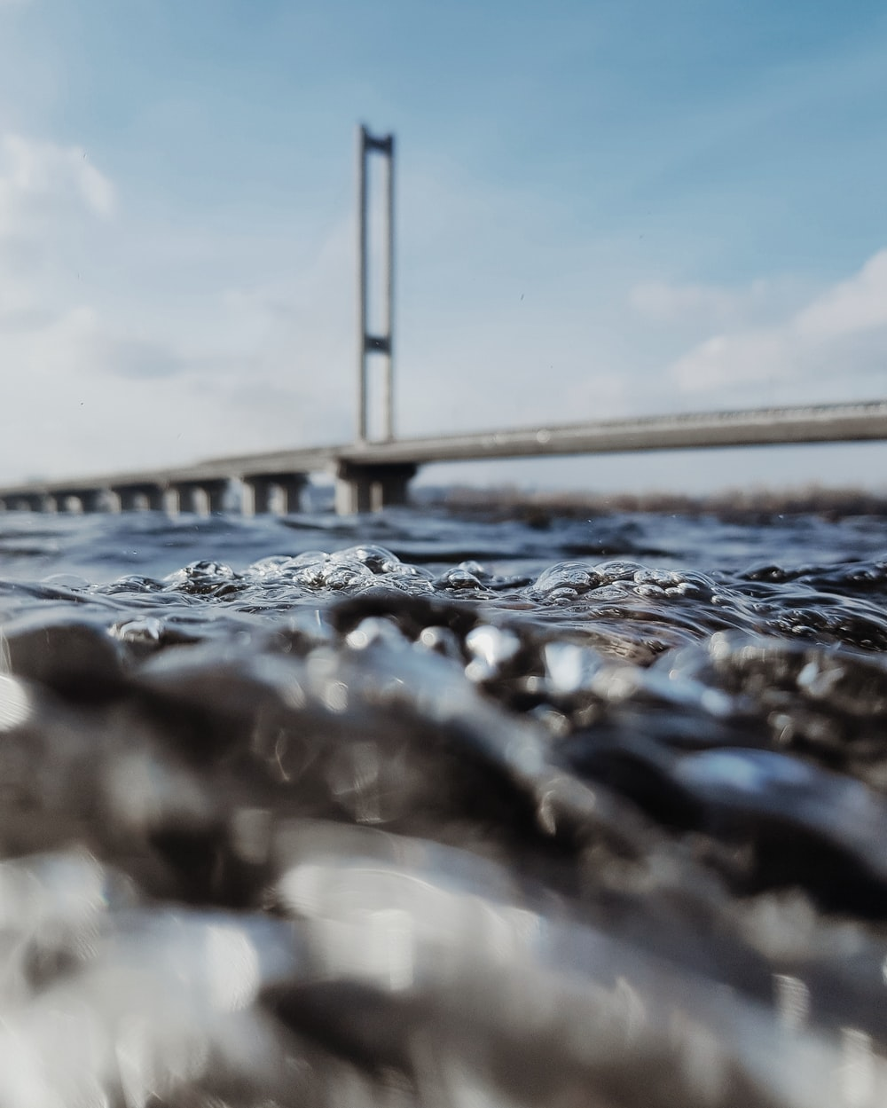 wavy body of water in close-up photography