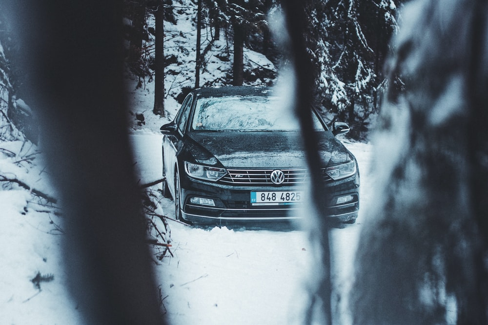 black Volkswagen car on snow field