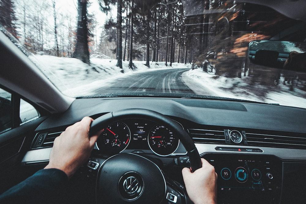 person driving Volkswagen vehicle