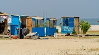 blue and brown wooden stalls near ocean