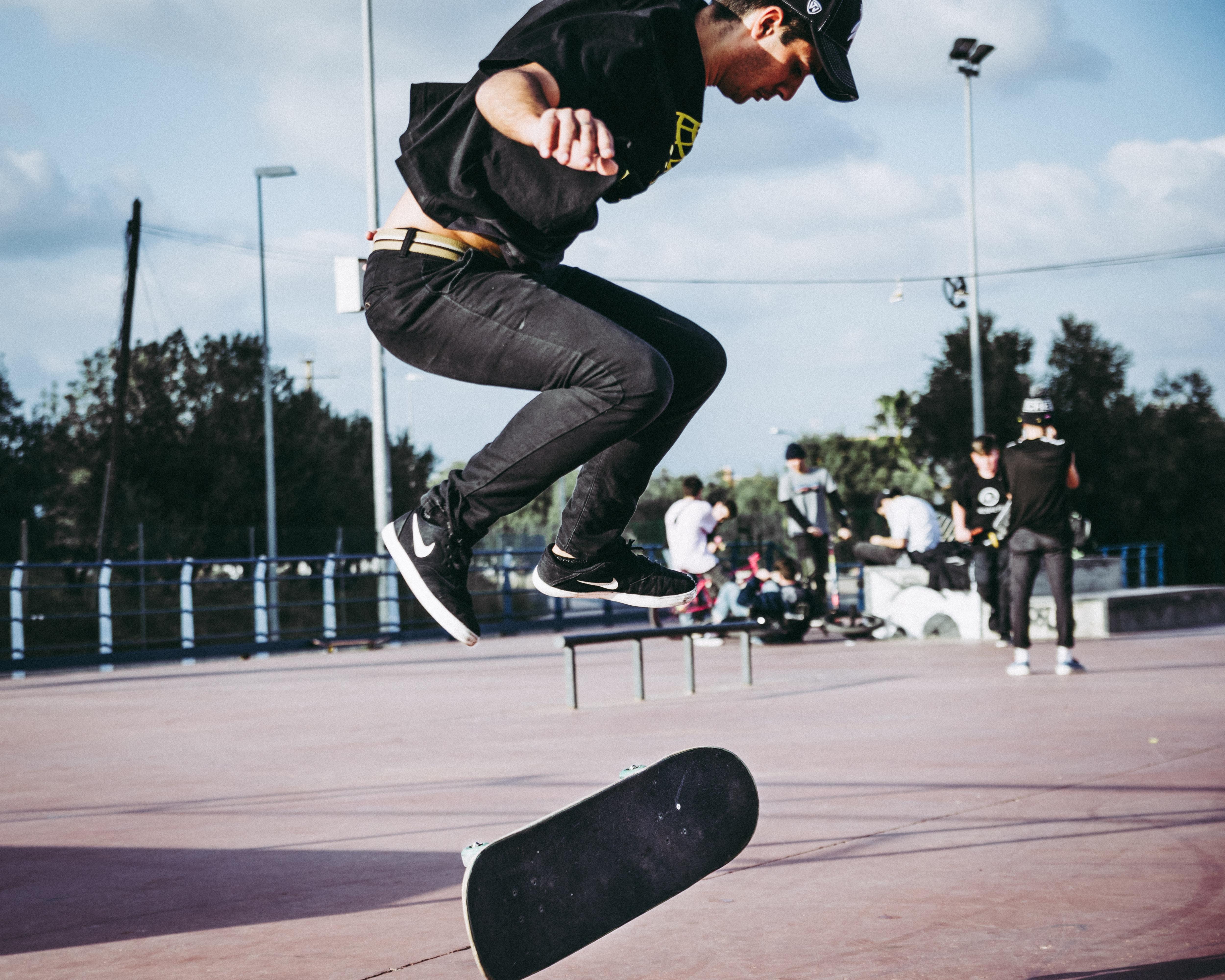 skateboarding man during daytime