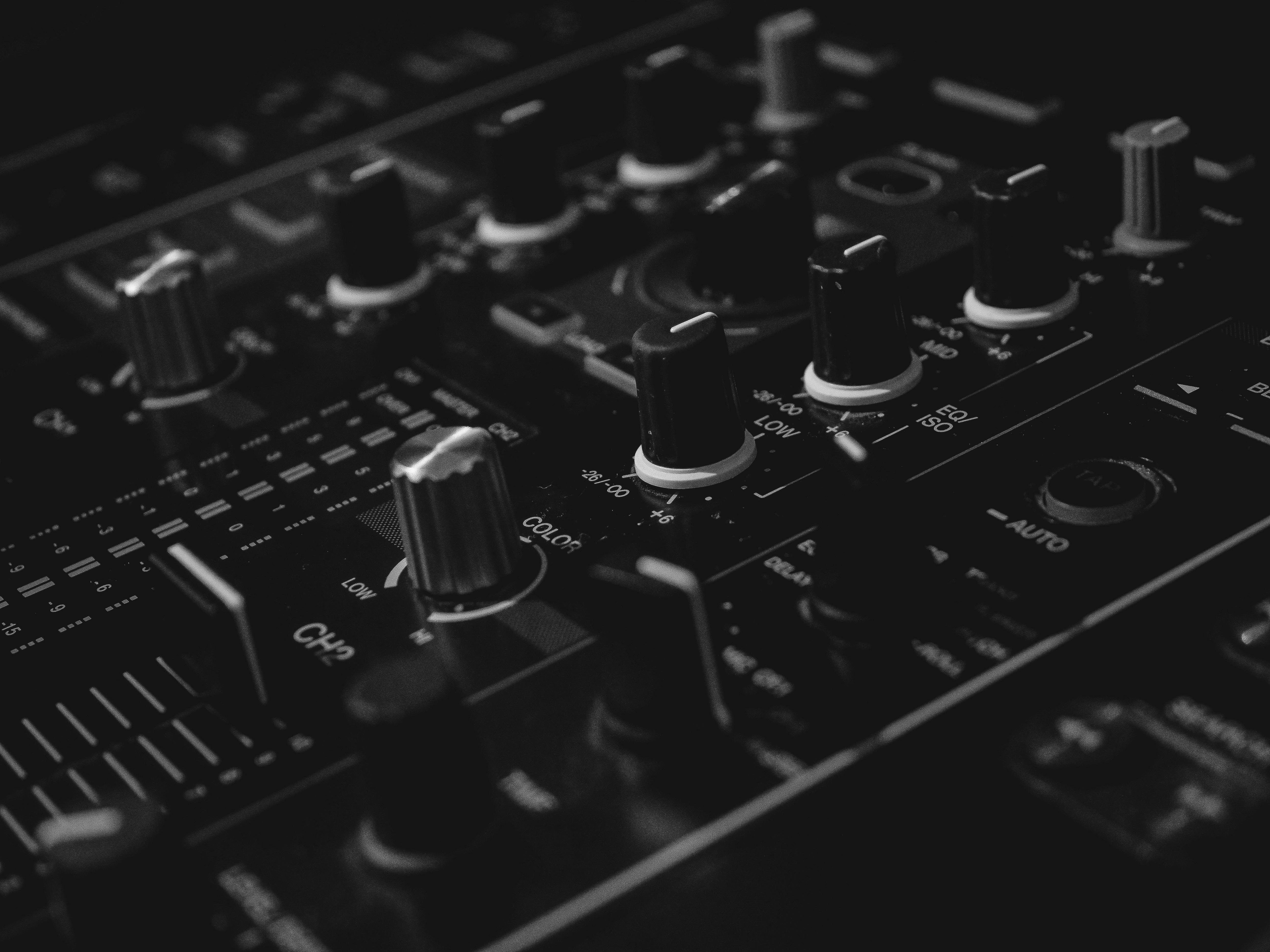 black audio mixer in closeup photography
