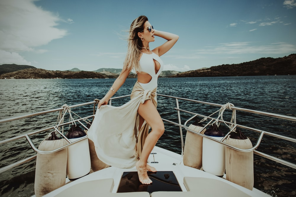 woman standing on boat during daytime