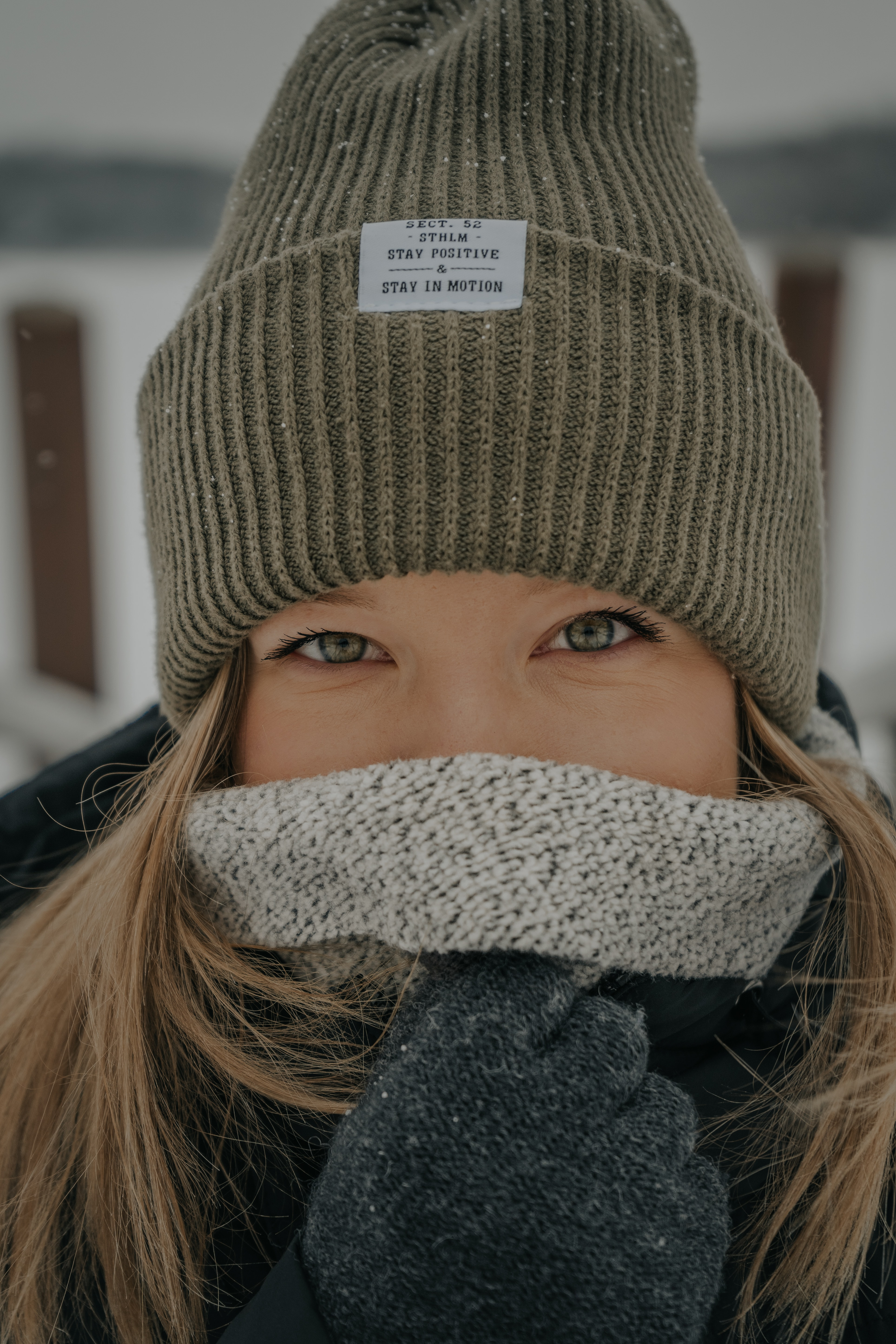 woman covering her face with coat
