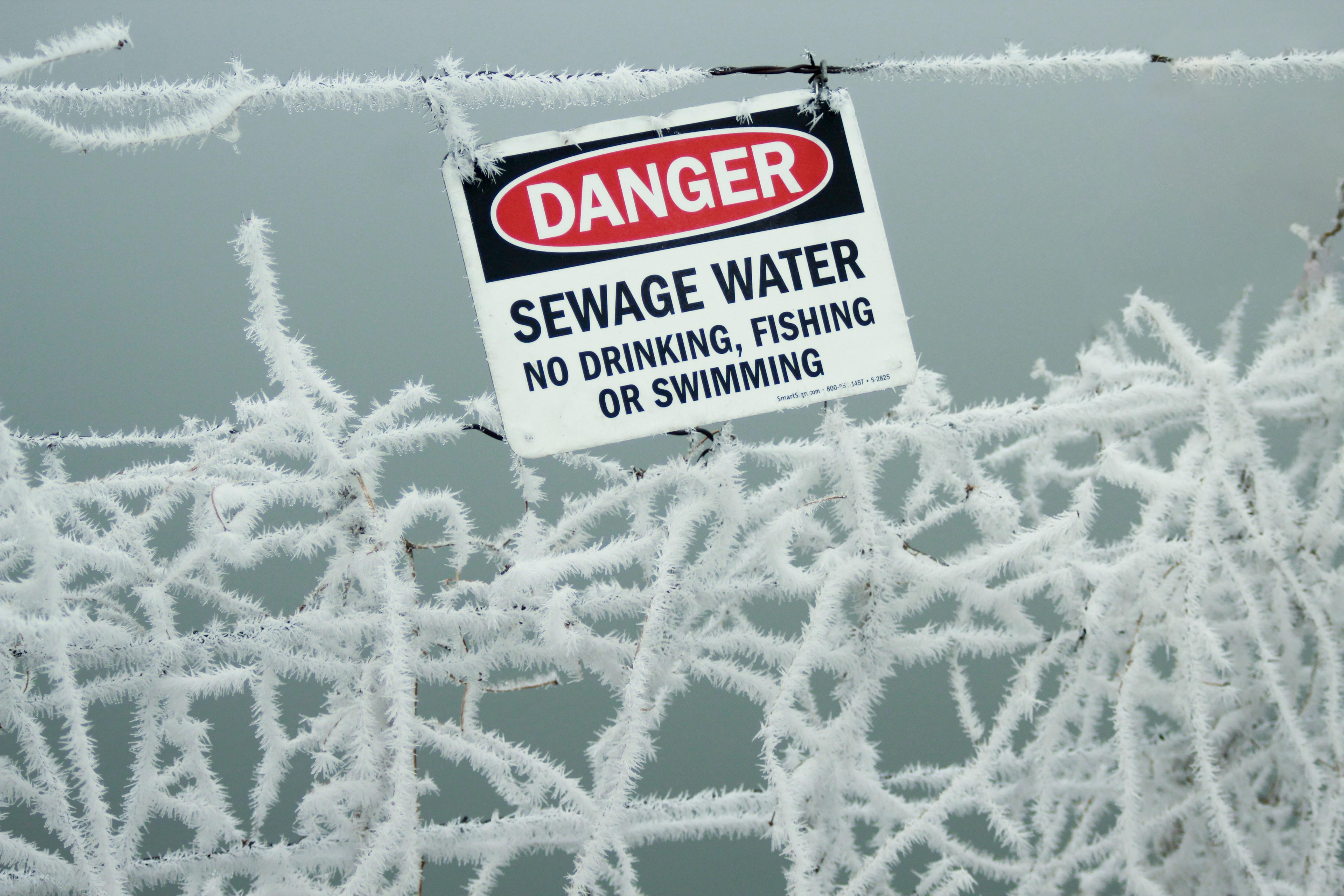 Danger sewage water signage