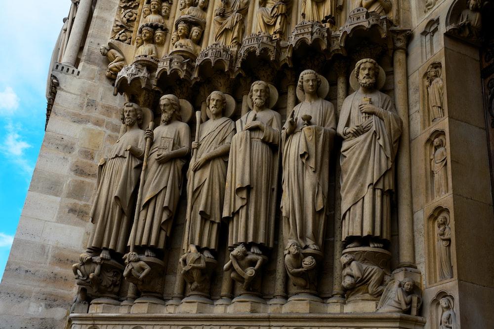 high-relief sculptures of men