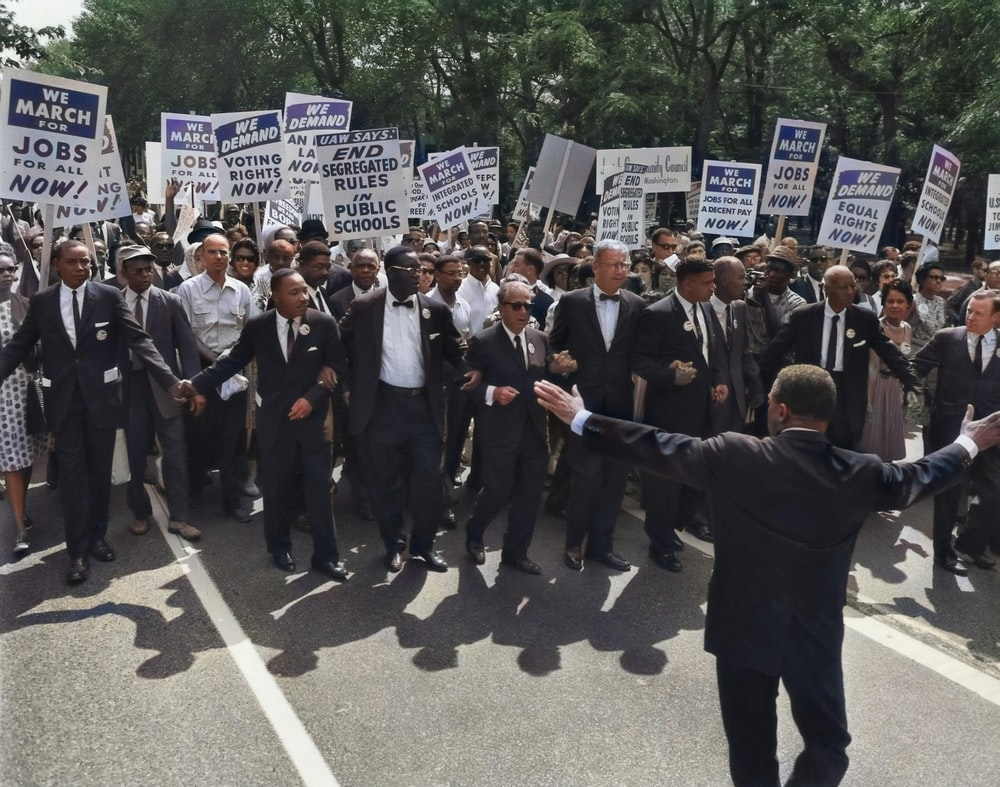 men in suit walking on street holding signages
