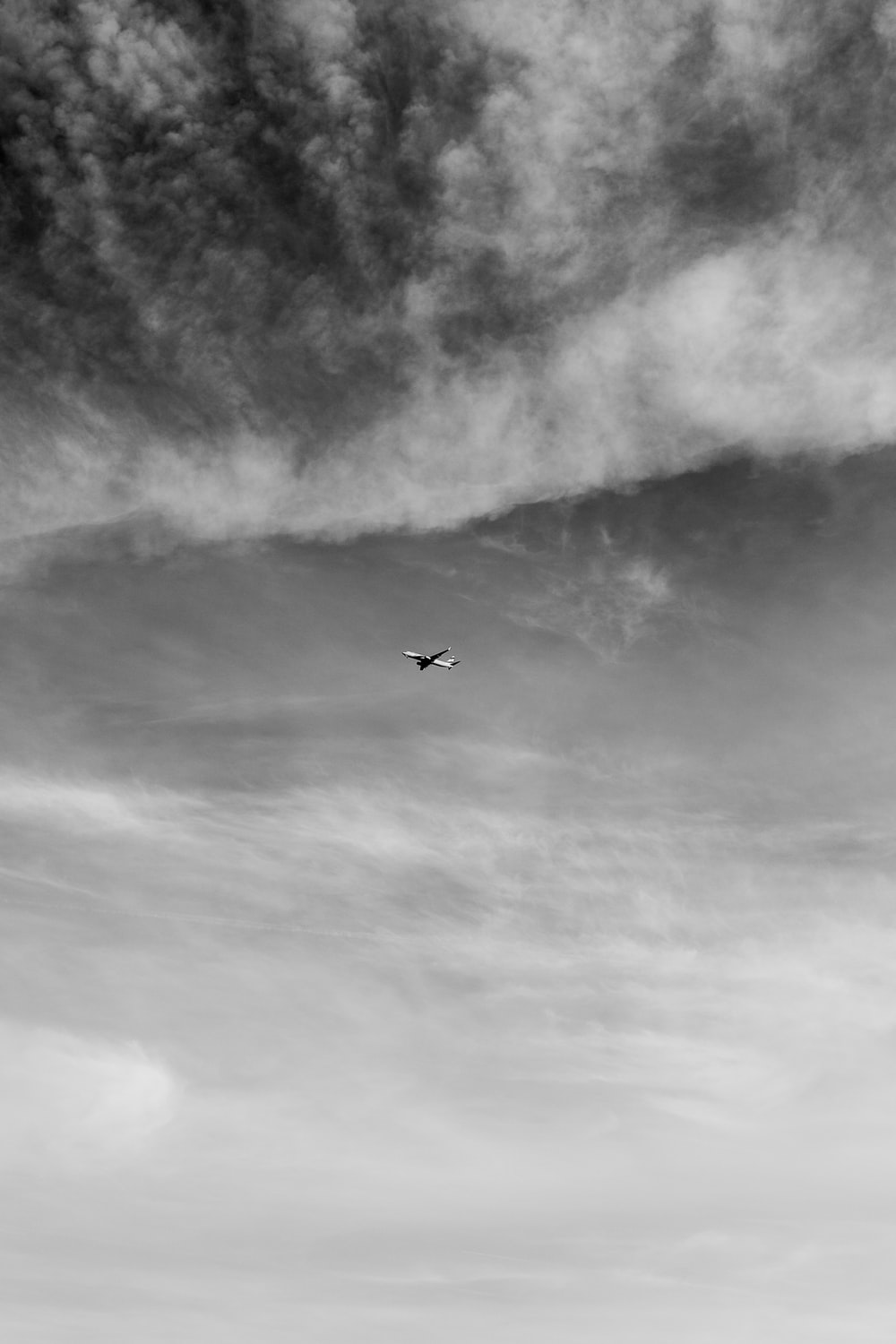 grayscale photo of airplane on sky