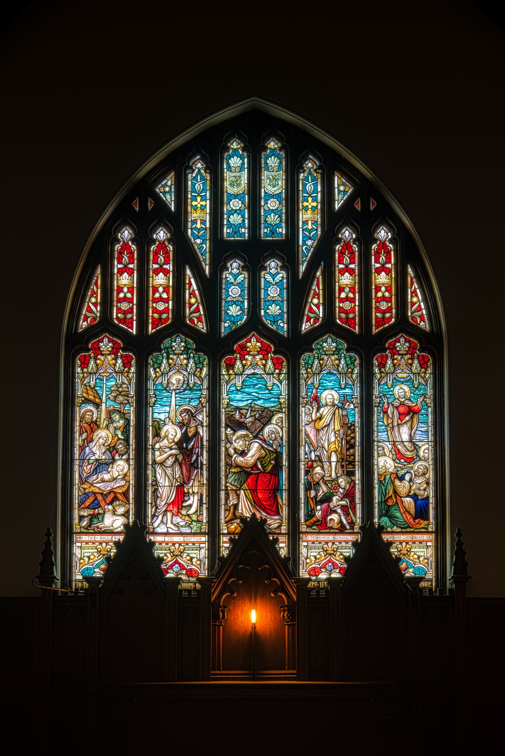 photo of blue and red religious stain glass decor