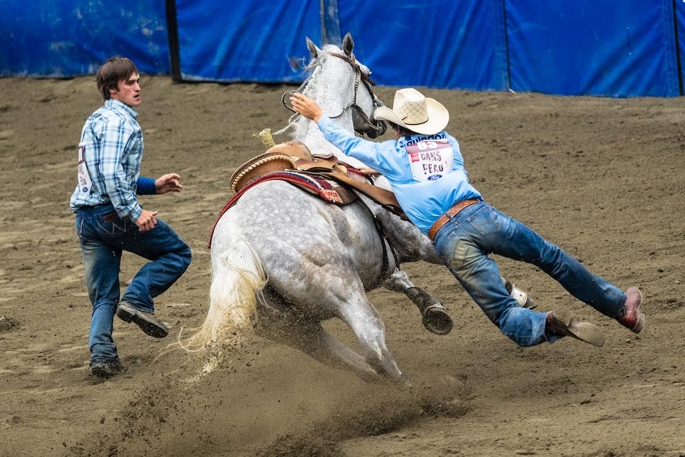 cowboy falling on horse