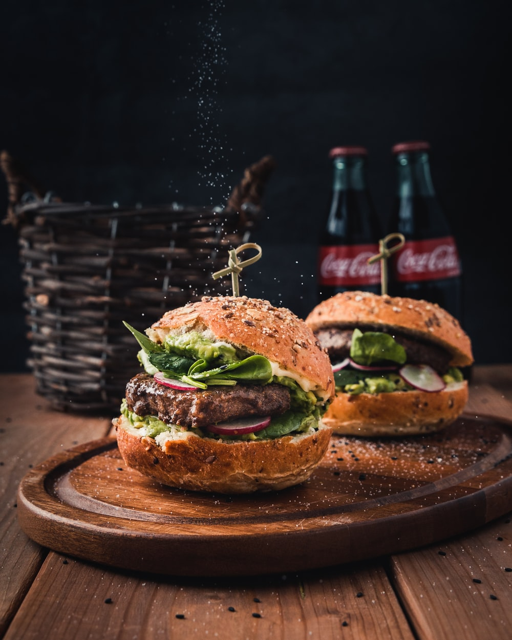 burger with vegetable on brown wooden tray