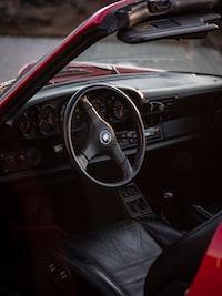 red vehicle with black steering wheel