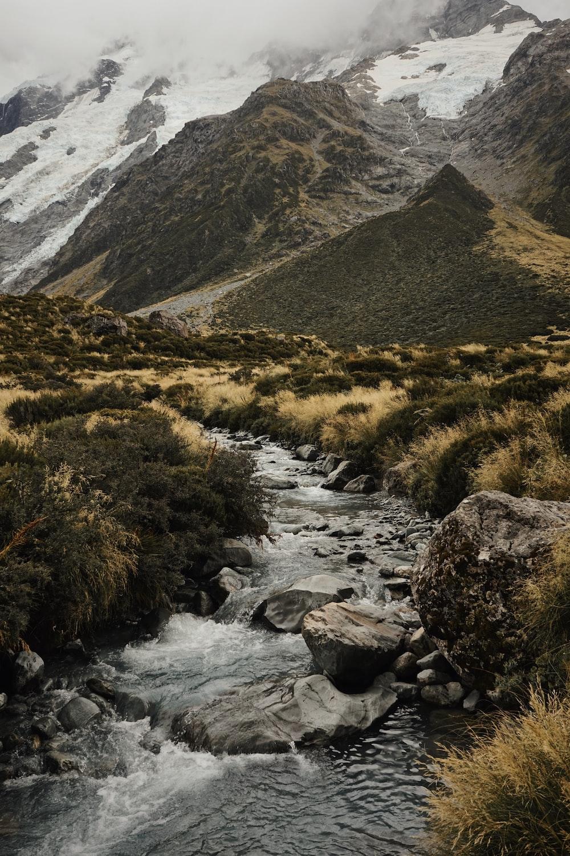 water stream near mountains