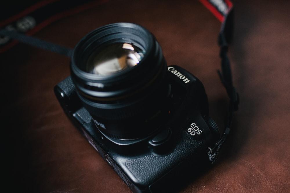 black Canon EOS 5D DSLR camera
