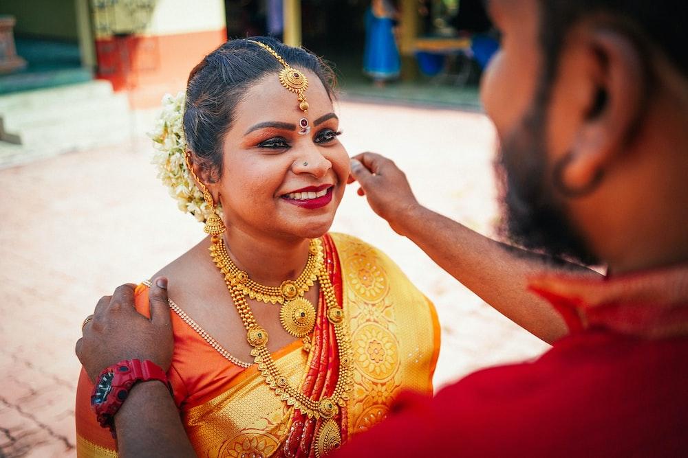 man holding woman's cheeks