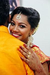 woman hugging man while smiling